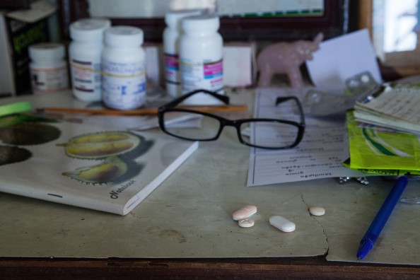 HIV medication is seen on a table inside one of the houses of the community on September 6, 2014 in Tuol Sambo, Cambodia.