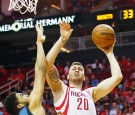 Donatas Motiejunas #20 of the Houston Rockets takes a shot over Karl-Anthony Towns #32 of the Minnesota Timberwolves during their game at the Toyota Center on March 18, 2016 in Houston, Texas.