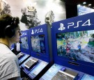 A gamer plays the video game 'For Honor' published by Ubisoft games editor on Sony PlayStation game console PS4 during the 'Paris Games Week'on October 26, 2016 in Paris, France.