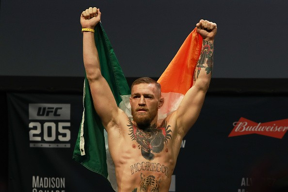 UFC Featherweight Champion Conor McGregor reacts as he walks on stage for UFC 205 Weigh-ins at Madison Square Garden on November 11, 2016 in New York City.