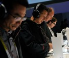 Attendees listen to music with Sony's MDR-1A headphones at the 2015 International CES at the Las Vegas Convention Center on January 6, 2015 in Las Vegas, Nevada.
