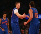 Kristaps Porzingis #6 of the New York Knicks celebrates a basket with teammate Joakim Noah #13 at Madison Square Garden on December 25, 2016 in New York City.