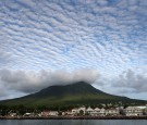 CHARLESTOWN, ST KITTS AND NEVIS - NOVEMBER 23: Cloud formations over the volcanic peak on Nevis on the fourth day of an official visit on November 23, 2016 in Port Zante, St Kitts and Nevis. Prince Harry's visit to The Caribbean marks the 35th Anniversary