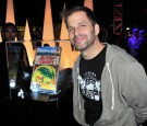 Director Zack Snyder poses in front of Action Comics issue #1 at DC Entertainment and Warner Bros. host Superman 75 party at San Diego Comic-Con at Hard Rock Hotel San Diego on July 19, 2013.