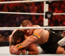 Seth Rollins and John Cena battle it out at the WWE SummerSlam 2015 at Barclays Center of Brooklyn on August 23, 2015 in New York City.