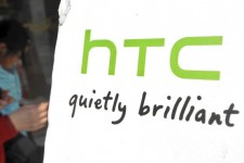 A woman walks past a HTC store in Taipei on February 4, 2013. Taiwan's top smartphone maker HTC said on February 4 its net profit in the three months to December plunged 91 percent from a year ago