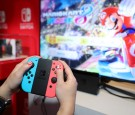 Nintendo of America, A guest enjoys playing Mario Kart 8 Deluxe on the groundbreaking new Nintendo Switch at a special preview event in New York on Jan. 13, 2017.