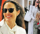 Angelina Jolie beams as she stuns in an all white ensemble while enjoying a day out in London with her kids