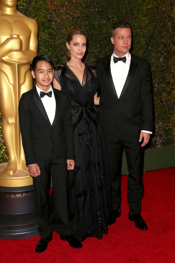 Maddox Jolie-Pitt, actress Angelina Jolie and actor Brad Pitt arrive at the Academy of Motion Picture Arts and Sciences' Governors Awards