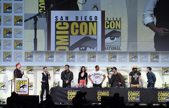 Moderator Conan O'Brien, director Zack Snyder, actors Ben Affleck, Gal Gadot, Ray Fisher, Ezra Miller, Jason Momoa and Henry Cavill attend the Warner Bros.