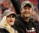 Musicians Gwen Stefani and Blake Shelton attend the NFL game between the Green Bay Packers and Arizona Cardinals at the University of Phoenix Stadium on December 27, 2015 in Glendale, Arizona.