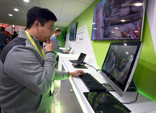 An attendee plays a video game at the Nvidia booth at CES 2017 at the Las Vegas Convention Center on January 5, 2017 in Las Vegas, Nevada.