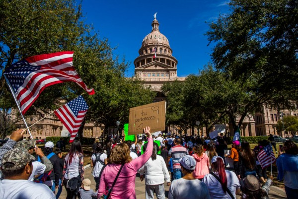 Texan lawmakers trade violent threats, scuffle over immigration protest