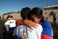 """Hugs Not Walls"" event brings separated families together for 3 minutes"