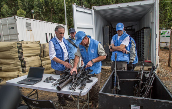 Colombia's FARC rebels turn their weapons over to UN monitors.