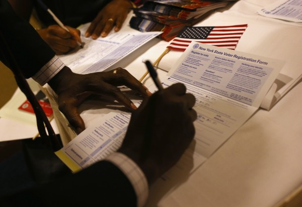 New American citizens register to vote